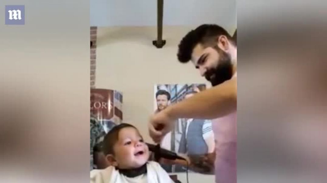Greek baby grins as he gets his first hair cut Daily Mail On-1.mp4