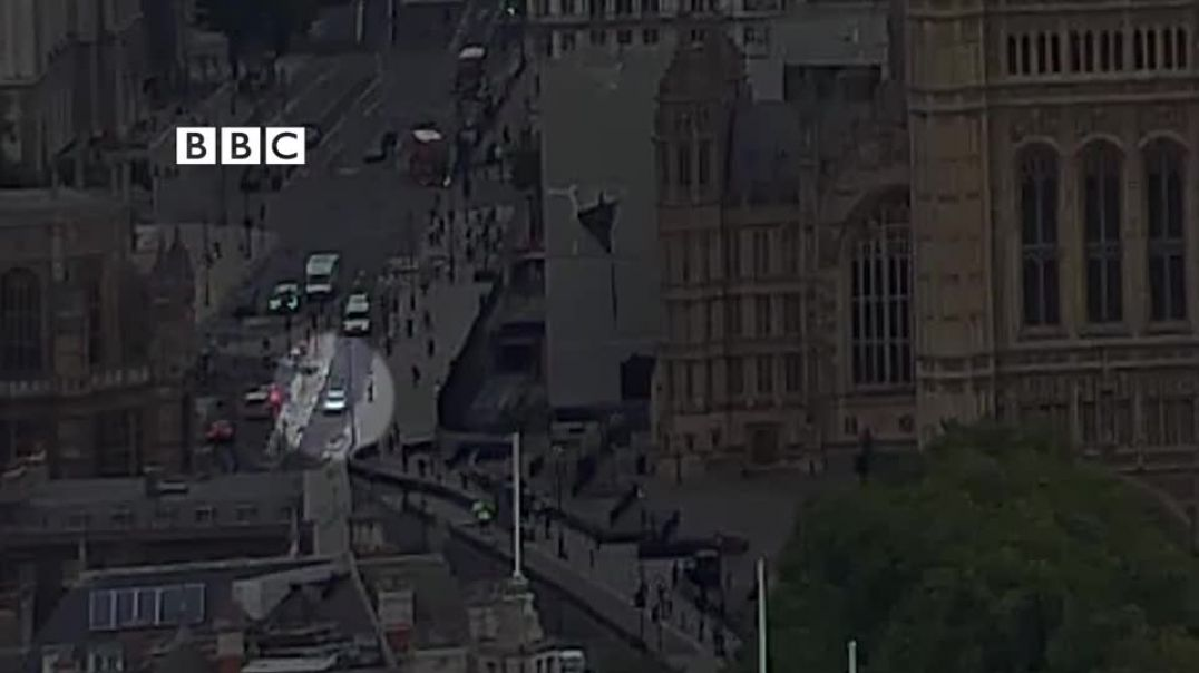 The car can be seen crashing into a barrier a UK parliament