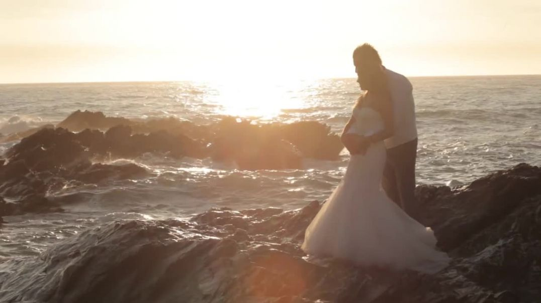 Viral Video UK Bride and Groom get soaked by rogue wave