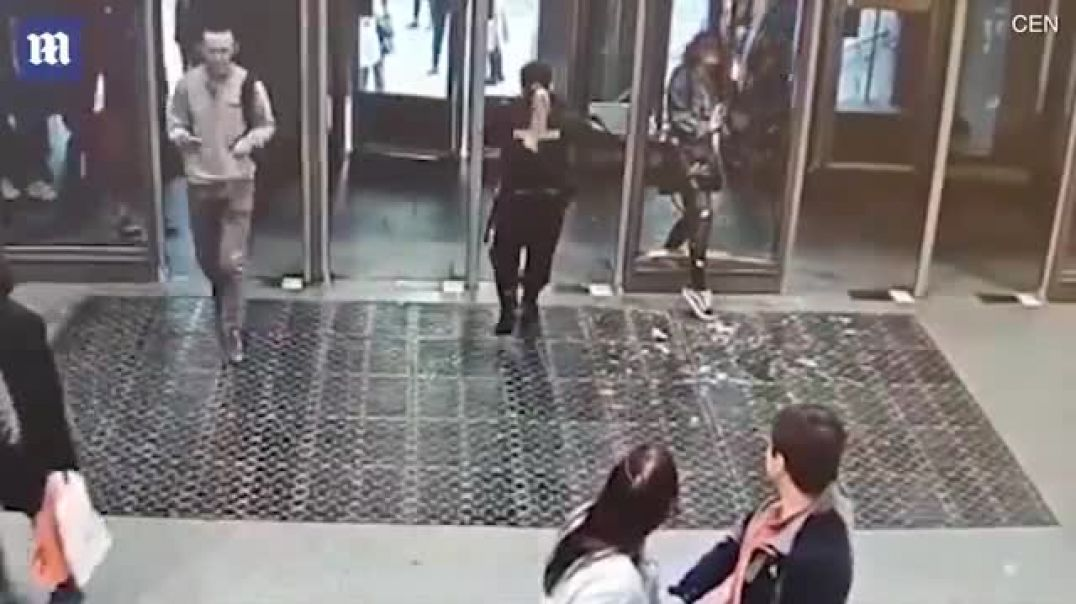 Moment woman walks straight through 'invisible' glass door