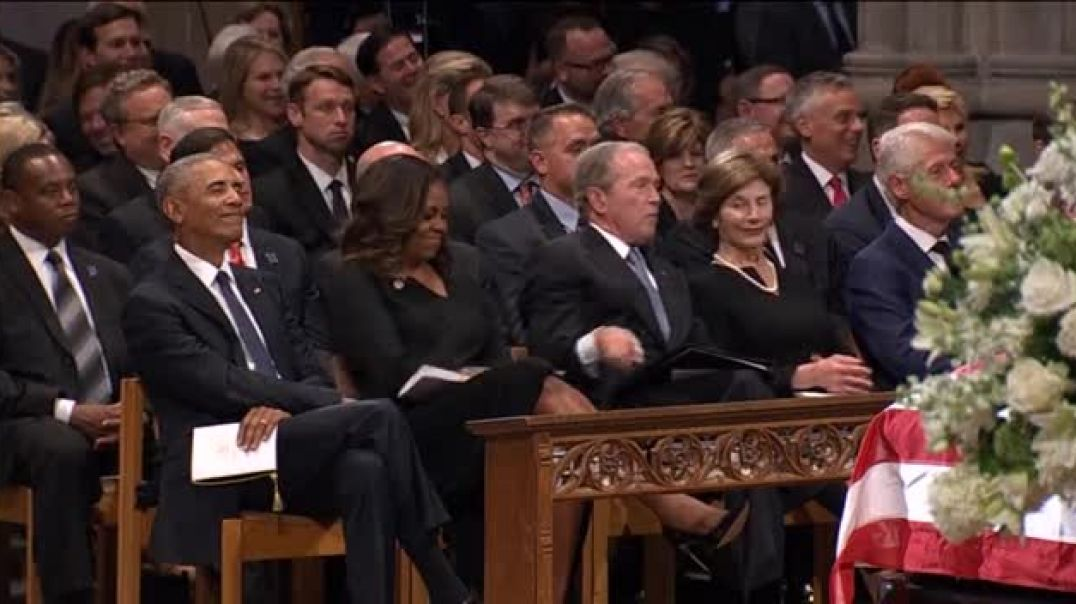 George W. Bush playfully SNEAKS candy to Michelle Obama at John McCain's memorial service