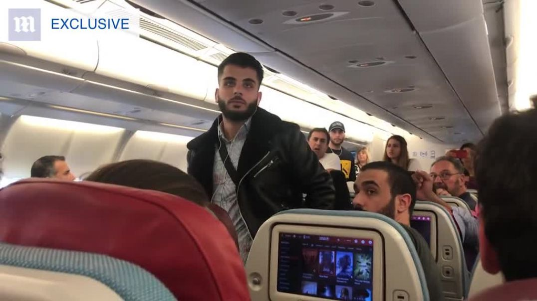 EXCLUSIVE Passengers help screaming man get kicked off a plane at Heathrow.m