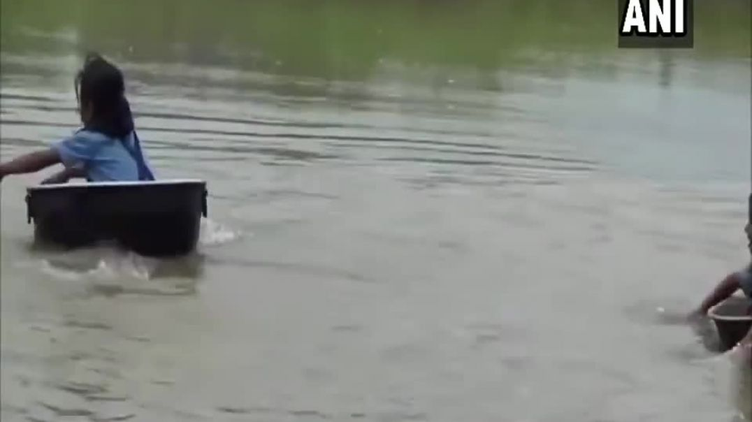 Watch- Kids Cross River In Aluminium Pots To Reach School In Assam.mp4