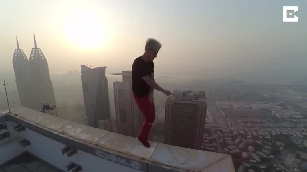 Daredevil Skips Along Dubai Roof Edge.mp4