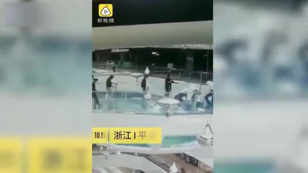 Woman trips and falls into a shark tank at FEEDING TIME before being saved at a Chinese mall.mp4
