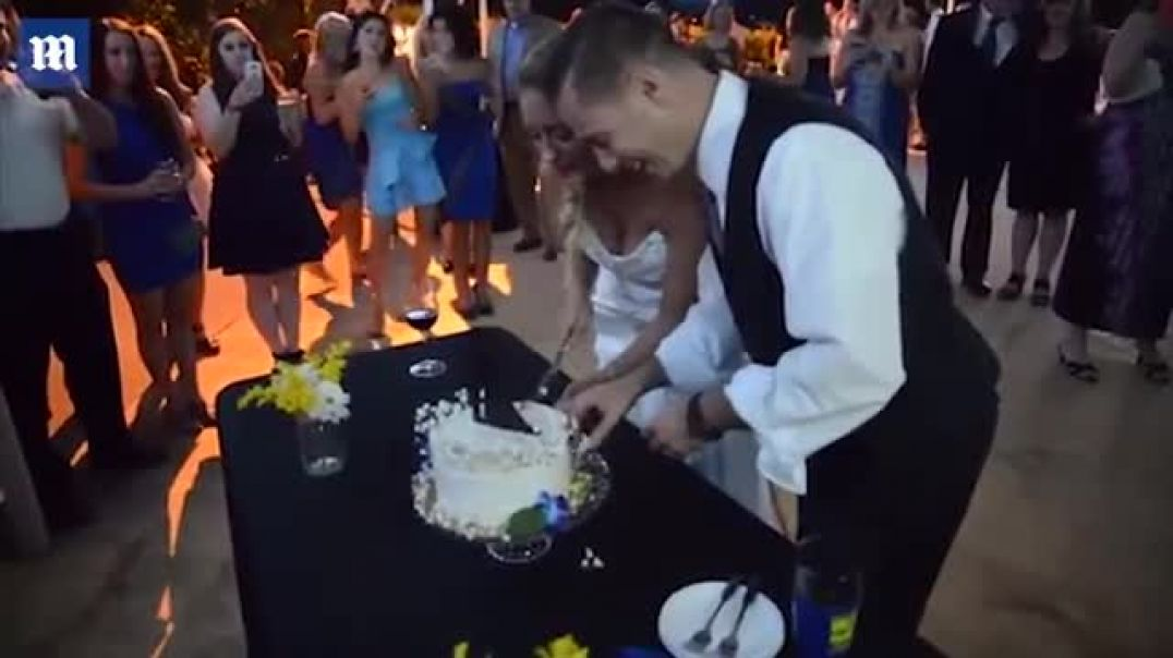 Groom knocks his new bride over during cake smash fail!