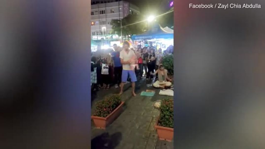 Russian dad swings his baby around during street performance