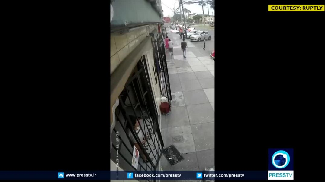Video- Small plane crashes on the streets of Lima.mp4