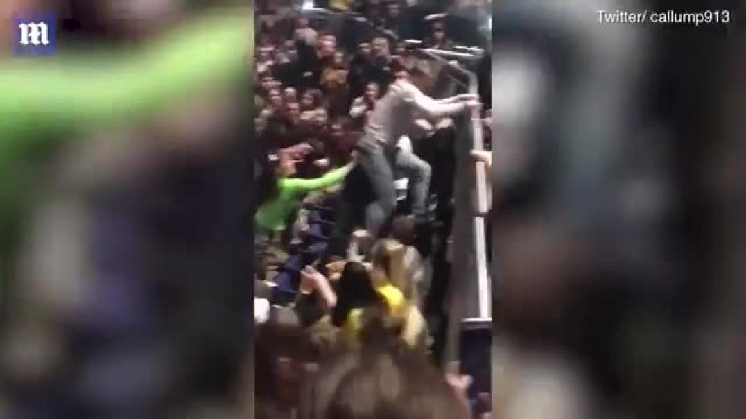Man filmed launching flying kick at woman at Post Malone concert London.mp4