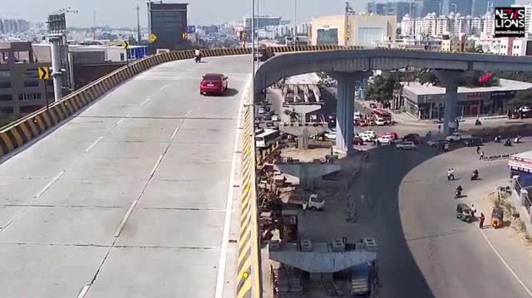 Horrific moment an out-of-control car plunges from a flyover