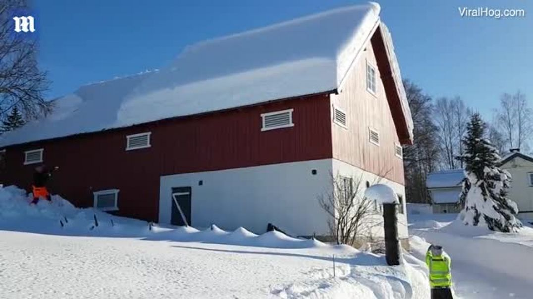 Norwegians use a rope to clear the snow off their barn roof in a dramatic avalanche
