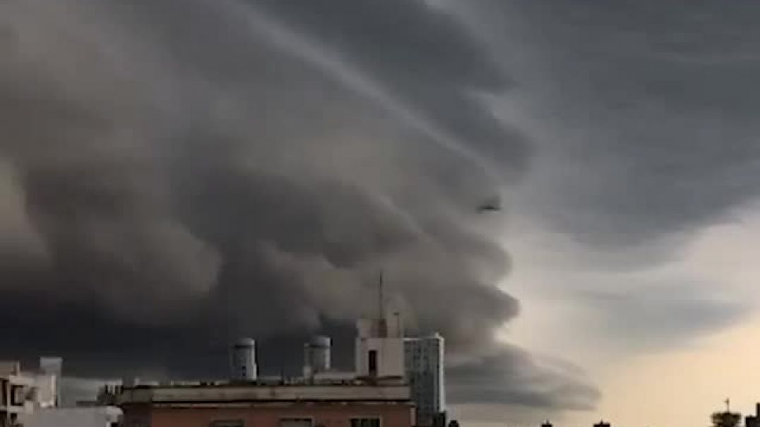 The lurking Cumulonimbus cloud slowly travelled over this city in Argentina