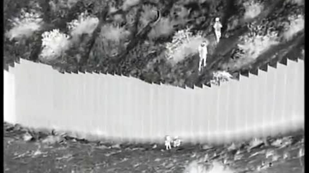 Smugglers, under cover of night, scaled a 14 ft. border barrier and cruelly dropped 2 young girl