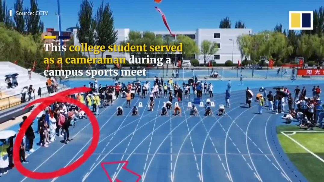 Speedy student cameraman keeps pace with sprinters in college dash in China.mp4