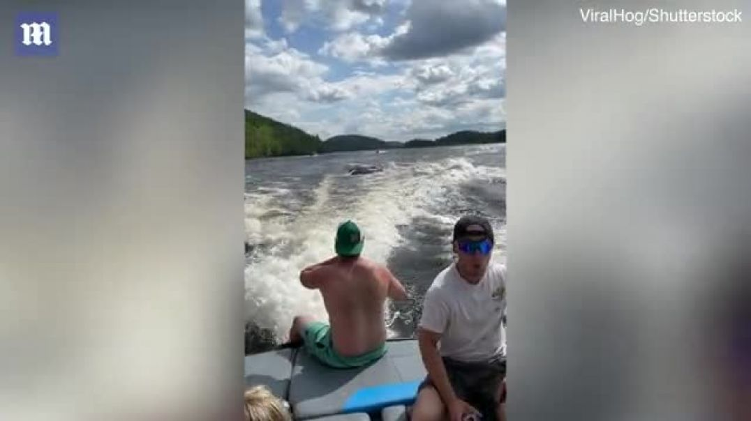 Moment jet skiers collide head-on and are thrown into the air as they race